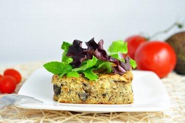 Gebackene Hirse mit Pilzen und Sardinen